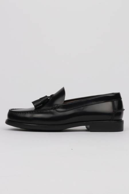 Black tassel loafers with...